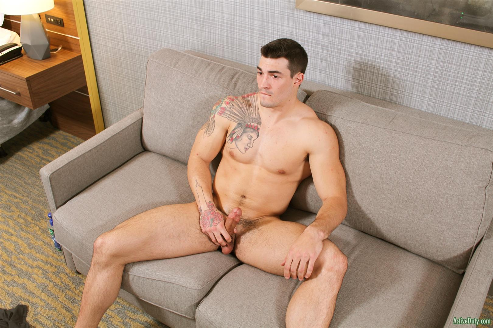 naked guy on a black couch